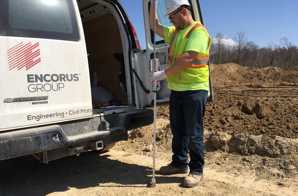 Encorus employee Evan Kolber is pictured here performing dynamic cone penetrometer testing on the subrade for the new roadways at the Arkwright Summit Wind Farm