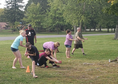 Encorus employees and their families gave their best effort in the water balloon toss