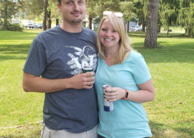 Encorus mechanical engineer Andy Wiedemann and guest stop for a photo at the Fall Family Picnic